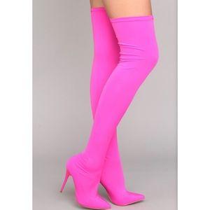 neon pink knee high boots.